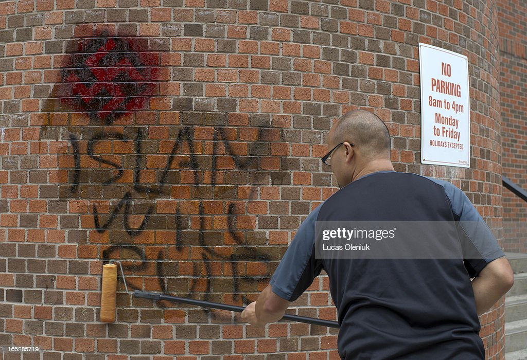 James Thom of Top Power Washing volunteered to remove antiSemitic graffiti from the back wall of the Beth Tikvah Synagogue in North York Friday...