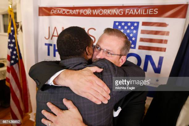 James Thompson gets a hug from supporter Djuan Wash left after Thompson came up short in his bid to beat Republican Ron Estes in a special election...