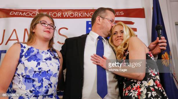 James Thompson kisses his wife Lisa while their daughter Liberty stands to the left after after Thompson came up short in his bid to beat Republican...