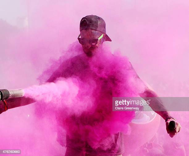 James Thorne is sprayed with colour on stage at The Color Run at London's Wembley Park on June 7 2015 in Wembley England The 19000 strong event...