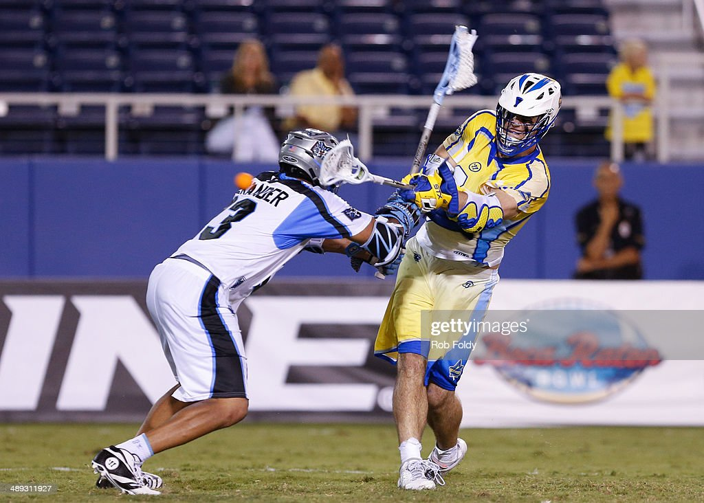 James Thul #9 of the Florida Launch shoots around Dominique Alexander #23 of the Ohio Machine during the second half of the game at Florida Atlantic University Stadium on May 10, 2014 in Boca Raton, Florida.
