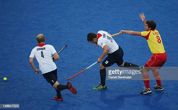 James Tindall of Great Britain and Alex Fabregas of Spain challenge for the ball during the Men's Hockey match between Great Britain and Spain on Day...