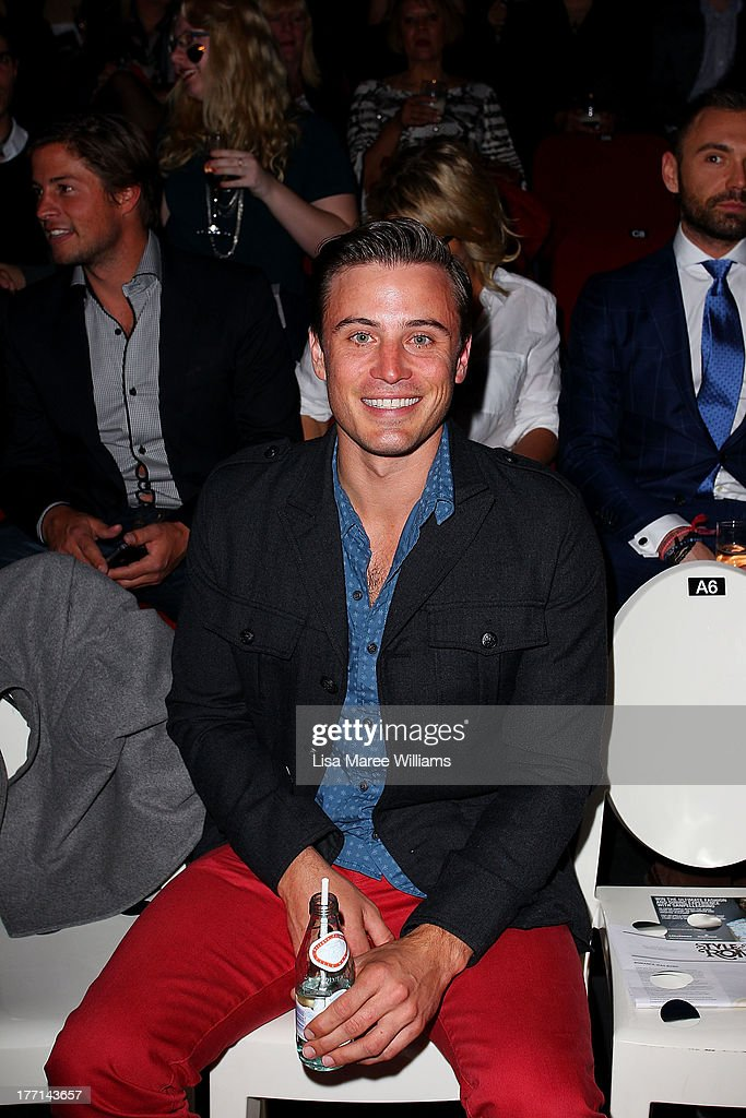 James Tobin watches the MBFWA Trends show during Mercedes-Benz Fashion Festival Sydney 2013 at Sydney Town Hall on August 21, 2013 in Sydney, Australia.