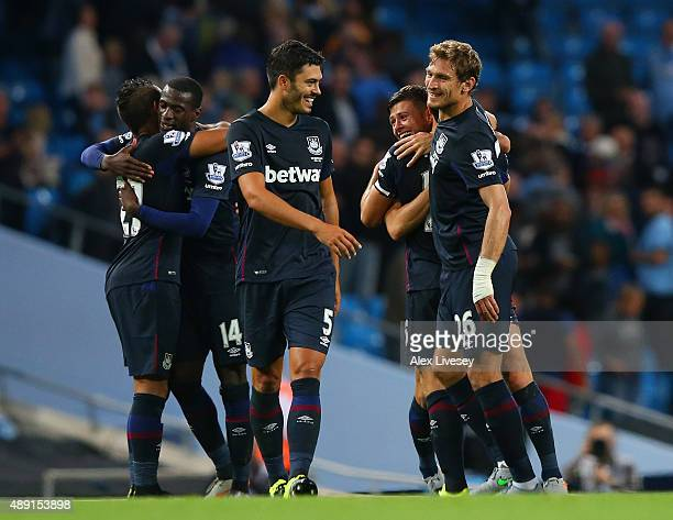 James Tomkins and Nikica Jelavic of West Ham United celebrate victory during the Barclays Premier League match between Manchester City and West Ham...