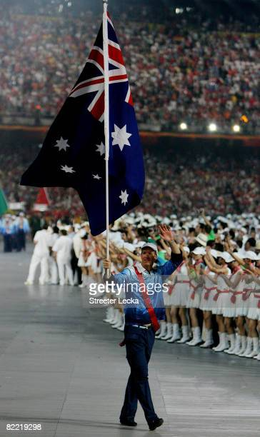 James Tomkins of Australia carries his country's flag during the Opening Ceremony for the 2008 Beijing Summer Olympics at the National Stadium on...