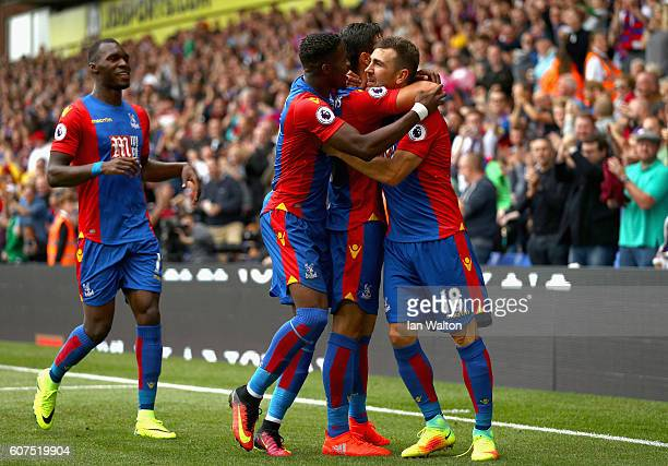James Tomkins of Crystal Palace celebrates scoring his sides first goal with his team mates during the Premier League match between Crystal Palace...