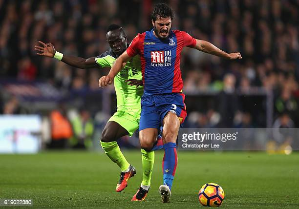 James Tomkins of Crystal Palace controls the ball under pressure of Sadio Mane of Liverpool during the Premier League match between Crystal Palace...