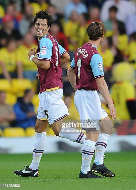 James Tomkins of West Ham smiles at Scott Parker after he scores their first goal during the npower Championship match between Watford and West Ham...