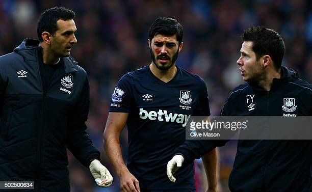James Tomkins of West Ham United receives medical attention during the Barclays Premier League match between Aston Villa and West Ham United at Villa...