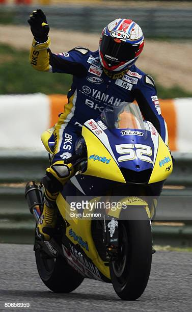 James Toseland of Great Britain and the Tech 3 Yamaha Team waves to the crowd after finishing 5th in the MotoGP of Portugal at the Estoril Circuit on...