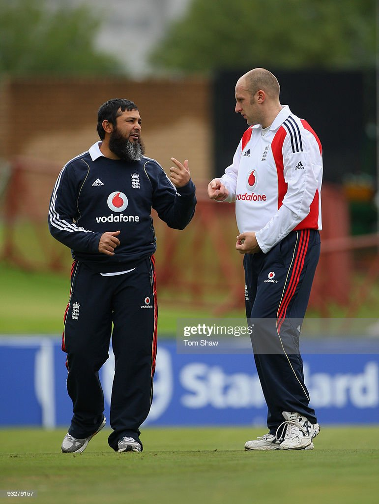James Treadwell of England has a chat with bowling coach Mushtaq Ahmed during the England nets session at Centurion Cricket Ground on November 21...