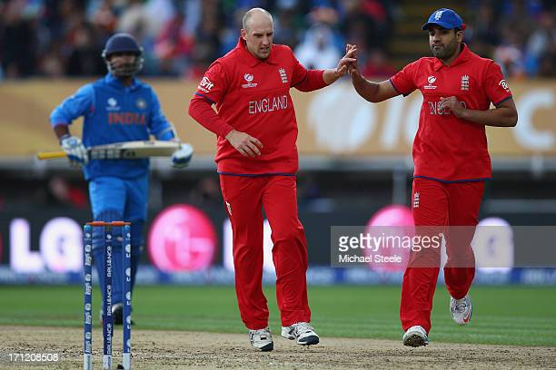 James Tredwell of England celebrates with Ravi Bopara after taking the wicket of Dinesh Karthik of India during the ICC Champions Trophy Final match...