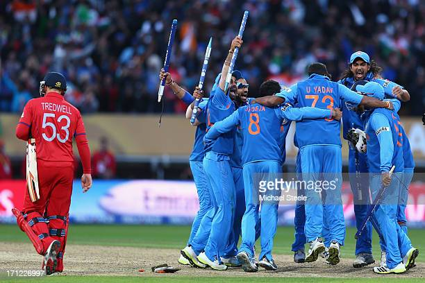 James Tredwell of England cuts a lonely figure as India players celebrate their 5 run victory during the ICC Champions Trophy Final match between...