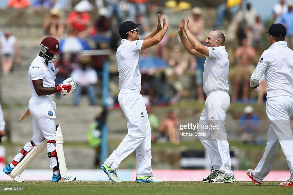 <a gi-track='captionPersonalityLinkClicked' href=/galleries/search?phrase=James+Tredwell&family=editorial&specificpeople=653013 ng-click='$event.stopPropagation()'>James Tredwell</a> (R) of England receives the congratulations from <a gi-track='captionPersonalityLinkClicked' href=/galleries/search?phrase=Alastair+Cook+-+Cricketspieler&family=editorial&specificpeople=571475 ng-click='$event.stopPropagation()'>Alastair Cook</a> after claiminge the wicket of <a gi-track='captionPersonalityLinkClicked' href=/galleries/search?phrase=Kemar+Roach&family=editorial&specificpeople=5408487 ng-click='$event.stopPropagation()'>Kemar Roach</a> (L) of West Indies during day three of the 1st Test match between West Indies and England at the Sir Vivian Richards Stadium on April 15, 2015 in Antigua, Antigua and Barbuda.