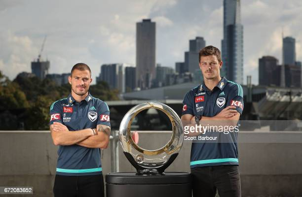 James Troisi and James Donachie pose with the Hyundai ALeague Championship Trophy during a Melbourne Victory ALeague media opportunity at AAMI Park...
