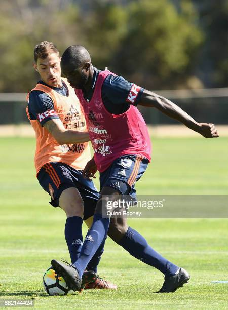 James Troisi and Jason Geria of the Victory compete for the ball during a Melbourne Victory ALeague training session at Gosch's Paddock on October 17...