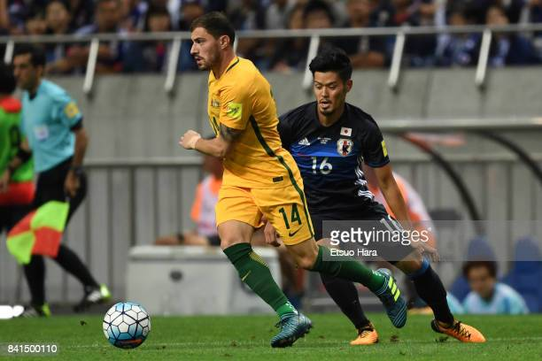 James Troisi of Australia and Hotaru Yamaguchi of Japan compete for the ball during the FIFA World Cup Qualifier match between Japan and Australia at...