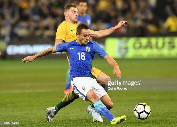 James Troisi of Australia and Marcio Rafael Souza of Brazil compete for the ball during the Brazil Global Tour match between Australian Socceroos and...
