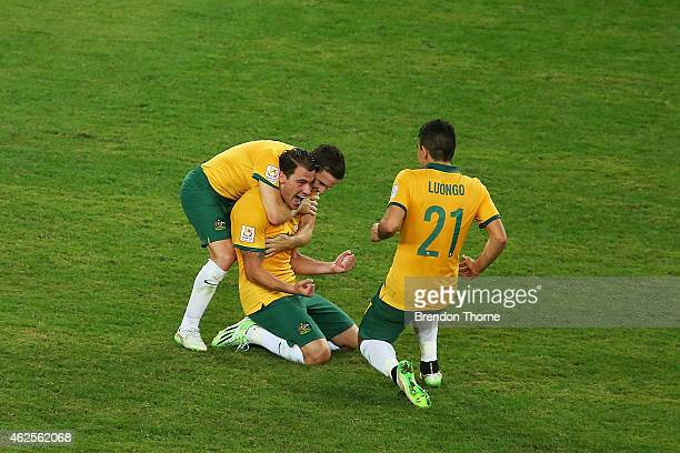 James Troisi of Australia celebrates with team mates Matt McKay and Massimo Luongo at full time after victory over Korea Republic following the 2015...