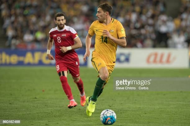 James Troisi of Australia competes for the ball with Mahmoud Al Mawas of Syria during the 2018 FIFA World Cup Asian Playoff match between the...