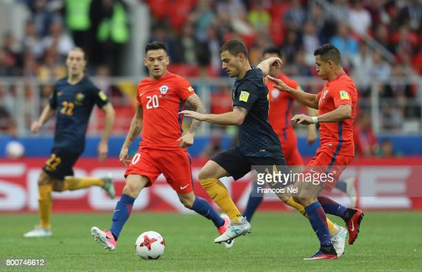 James Troisi of Australia goes past Charles Aranguiz and Alexis Sanchez of Chile during the FIFA Confederations Cup Russia 2017 Group B match between...