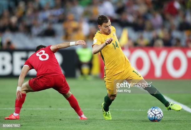 James Troisi of Australia is challenged by Mahmoud Al Mawas of Syria during the 2018 FIFA World Cup Asian Playoff match between the Australian...
