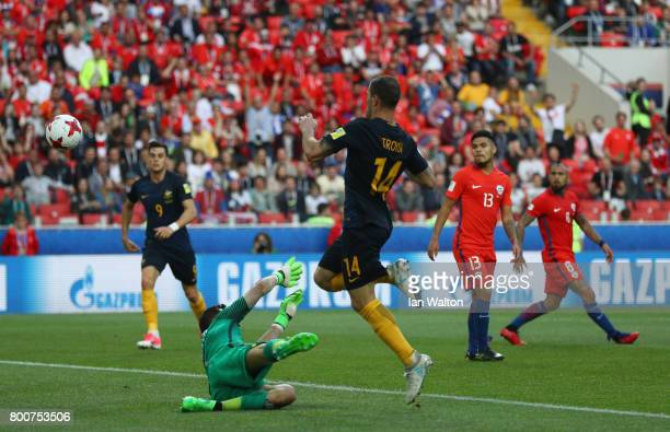 James Troisi of Australia scores his sides first goal past Claudio Bravo of Chile during the FIFA Confederations Cup Russia 2017 Group B match...
