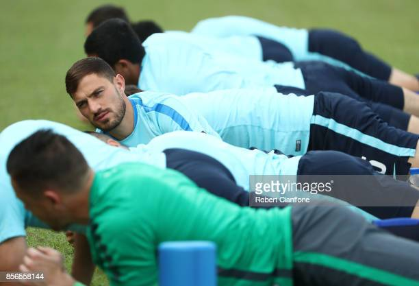 James Troisi of Australia stretches during an Australia Socceroos training session at Hang Tuah Stadium on October 2 2017 in Malacca Malaysia