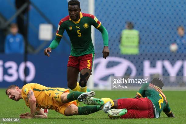 James Troisi of the Australia national football team and Michael Ngadeu Ngadjui Ernest Mabouka of the Cameroon national football team vie for the...