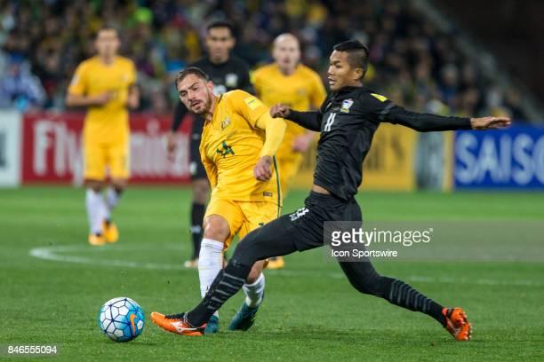 James Troisi of the Australian National Football Team and Mongkol Thosakrai of the Thailand National Football Team contest the ball during the FIFA...