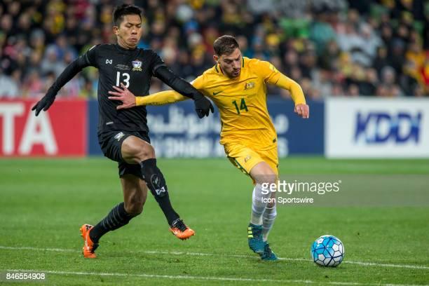 James Troisi of the Australian National Football Team and Pansa Hemviboon of the Thailand National Football Team contest the ball during the FIFA...