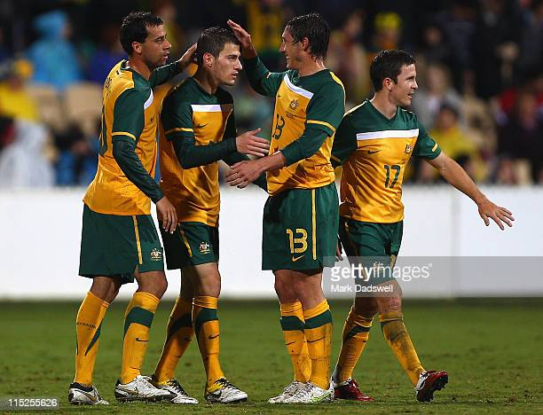 James Troisi of the Socceroos is congratulate by teammates after scoring a goal during the International Friendly match between the Australian...
