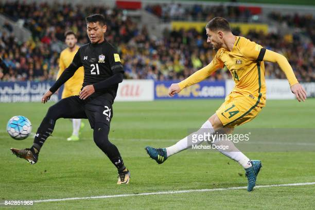 James Troisi of the Socceroos kicks the ball past Pakklaw Anan of Thailand during the 2018 FIFA World Cup Qualifier match between the Australian...
