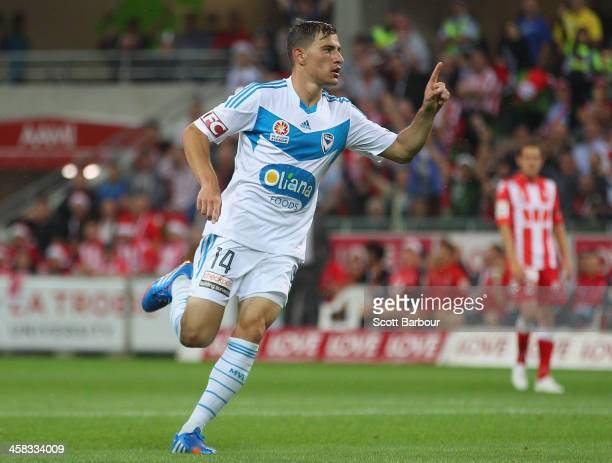 James Troisi of the Victory celebrates after scoring a goal during the round 11 ALeague match between Melbourne Heart and Melbourne Victory at AAMI...