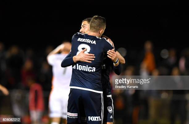 James Troisi of the Victory celebrates with tea mate Besart Berisha after scoring a goal during the FFA Cup round of 32 match between the Brisbane...
