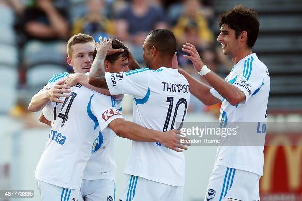 James Troisi of the Victory celebrates with team mates after scoring during the round 18 ALeague match between the Central Coast Mariners and the...