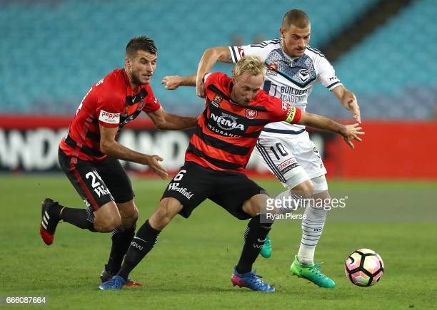 James Troisi of the Victory competes for the ball against Mitch Nichols and Terry Antonis of the Wanderers during the round 26 ALeague match between...