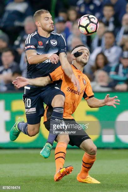 James Troisi of the Victory competes with Jack Hingert of the Roar during the ALeague Semi Final match between Melbourne Victory and the Brisbane...