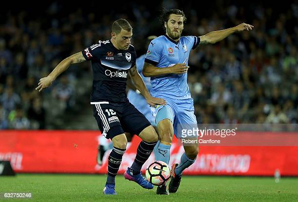 James Troisi of the Victory is challenged by Josh Brillante of Sydney FC during the round 17 ALeague match between the Melbourne Victory and Sydney...