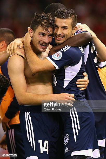 James Troisi of the Victory is congratulated by Kosta Barbarouses after scoring a goal during the AFC Asian Champions League match between the...