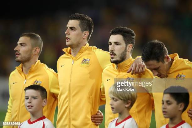 James Troisi Tomi Juric Milos Degenek and Nathan Burns of the Socceroos sing the anthem before the 2018 FIFA World Cup Qualifier match between the...