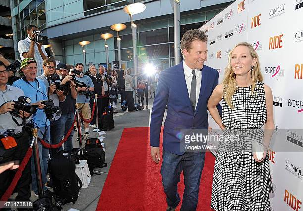 James Tupper and actress Anne Heche arrive at the premiere of 'Ride' at ArcLight Hollywood on April 28 2015 in Hollywood California