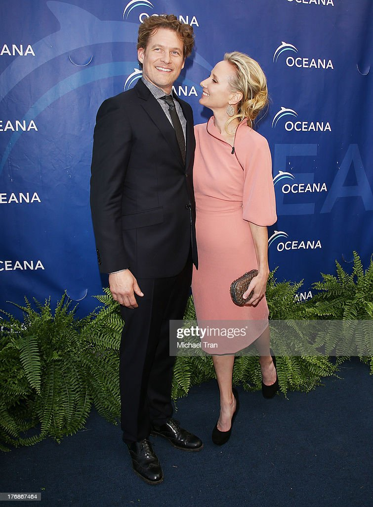 <a gi-track='captionPersonalityLinkClicked' href=/galleries/search?phrase=James+Tupper&family=editorial&specificpeople=619618 ng-click='$event.stopPropagation()'>James Tupper</a> (L) and <a gi-track='captionPersonalityLinkClicked' href=/galleries/search?phrase=Anne+Heche&family=editorial&specificpeople=202988 ng-click='$event.stopPropagation()'>Anne Heche</a> arrive at the 6th Annual Oceana's Annual SeaChange Summer Party held at a private residence on August 18, 2013 in Laguna Beach, California.