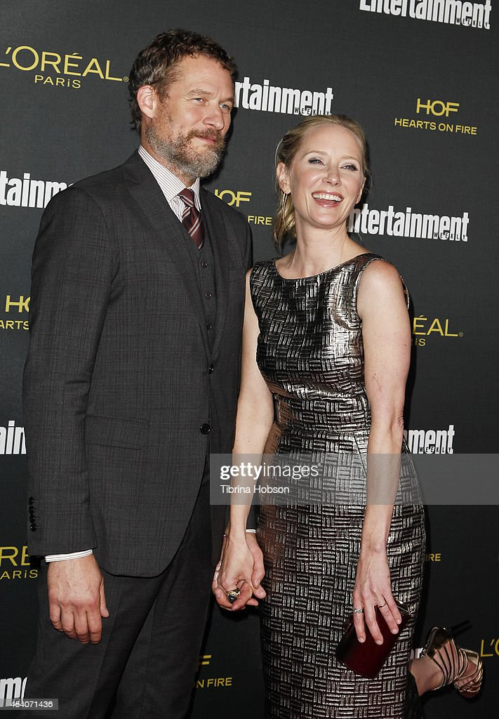 James Tupper and Anne Heche attend Entertainment Weekly's Pre-Emmy party at Fig & Olive Melrose Place on August 23, 2014 in West Hollywood, California.