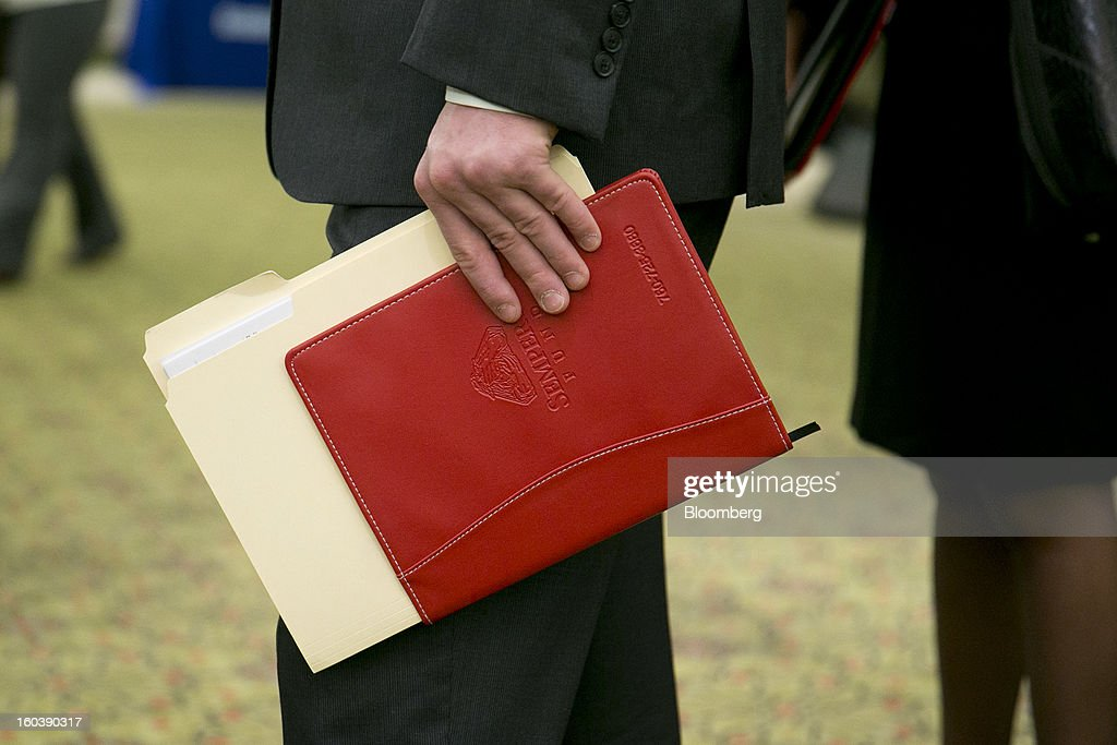James Turner holds his resume and a folder of notes while waiting in line to speak to a job recruiter at a National Career Fairs job fair in Arlington, Virginia, U.S., on Wednesday, Jan. 30, 2013. The U.S. Labor Department is scheduled to release initial jobless claims data on Jan. 31. Photographer: Andrew Harrer/Bloomberg via Getty Images
