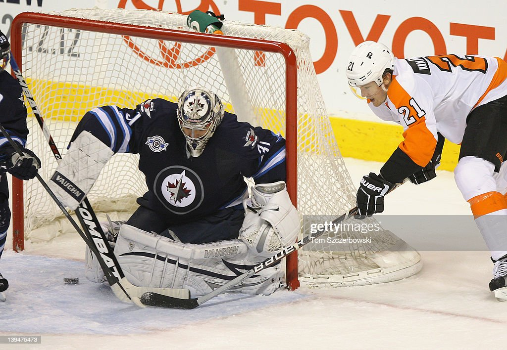 James van Riemsdyk #21 of the Philadelphia Flyers attempts a wrap around during their NHL game against Ondrej Pavelec #31 of the Winnipeg Jets at MTS Centre on February 21, 2012 in Winnipeg, Manitoba, Canada.