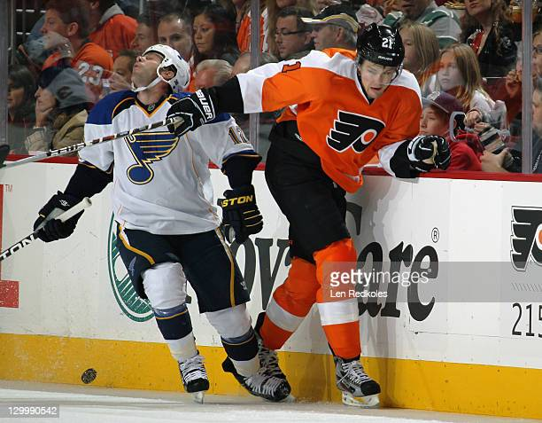 James van Riemsdyk of the Philadelphia Flyers highsticks Scott Nichol of the St Louis Blues along the boards on October 22 2011 at the Wells Fargo...