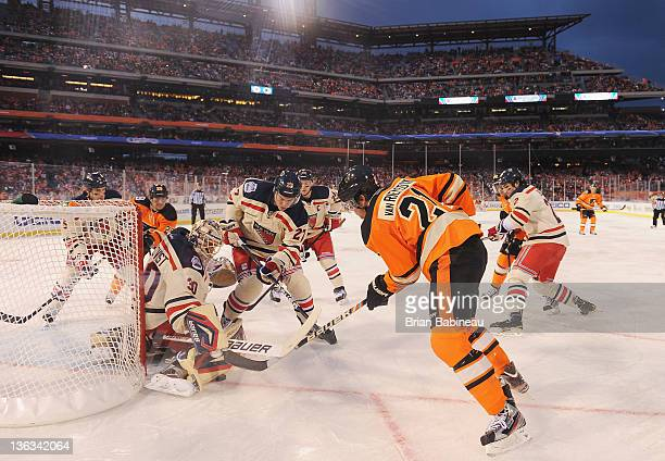 James van Riemsdyk of the Philadelphia Flyers is denied by goaltender Henrik Lundqvist of the New York Rangers during the 2012 Bridgestone NHL Winter...