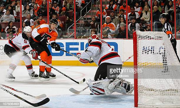James van Riemsdyk of the Philadelphia Flyers scores on this shot past goaltender Johan Hedberg of the New Jersey Devils on January 8 2011 at the...