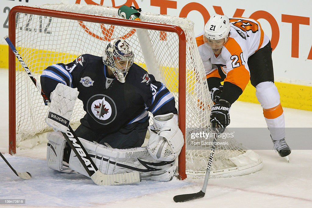 James van Riemsdyk #21 of the Philadelphia Flyers tries a wrap-around attempt during their NHL game against Ondrej Pavelec #31 of the Winnipeg Jets at MTS Centre on February 21, 2012 in Winnipeg, Manitoba, Canada.